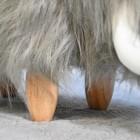 Close up of light wooden legs