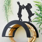 Wall Mounted Boxing Hares Iron Hose Holder Mounted to a Grey Garden Wall