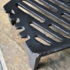 Close up of corner on curved fire grate
