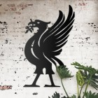 Liver Bird Wall Art on the Wall Next to Plants on a Rustic Wall