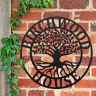 """Tree of Life"" Circular Iron House Name Sign  Mounted o a Brick Wall"