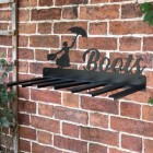 Wall Mounted Liver Bird Iron Boot Holder Mounted on a Brick Wall