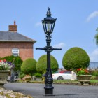 Miniature Victorian Lamp Post in Use on a Driveway in Front of a House