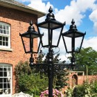 Black Victorian lanterns on ornate brackets