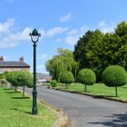 Vintage Green Opulent Cast Iron Lamp Post Installed In Period Driveway