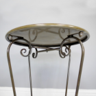 Scrolled Metal Work On The Legs Of The Side Table