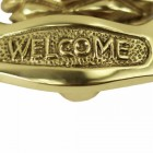 Welcome text on the polished brass pineapple door knocker