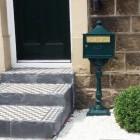 """Wilderness Falls"" Green Suffolk Post Box outside house"