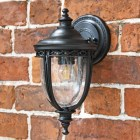 """Winsford"" Traditional Top Fix Black Wall Lantern in Situ on a Brick Wall"