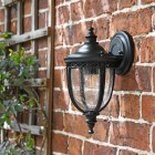 """Winsford"" Traditional Top Fix Black Wall Lantern in Situ on the Front of the House"