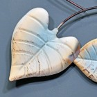 Close-up of the Rustic Cream and Blue Finish on the Leaf
