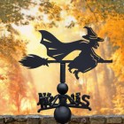 Witch Riding Broom Weathervane in Use in by Autumn Coloured Trees