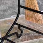 Close-up of the Black Finish on the Wrought Iron Log Holder