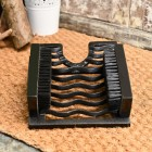 Black cast iron boot brush for interior or exterior use.