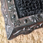 Close up of decorative detailing on cast iron base