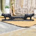 Black Ornate Cow with Bell Boot Scraper in Situ
