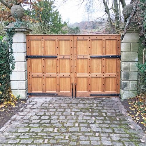 Beautiful wooden gates with blacksmith door studs