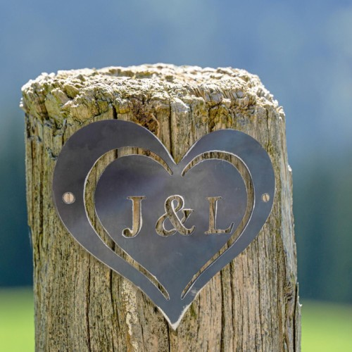 """7"""" Iron Initial Heart in Situ on a  Fence Panel"""