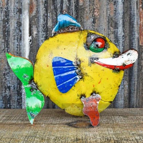 Round fish sculpture made from recycled oil drums