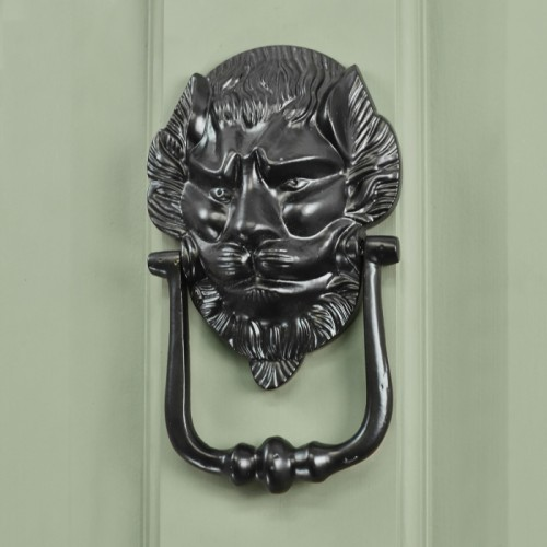 Black Lion Door Knocker in Situ on a Green Door