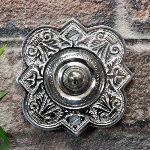 vintage bright chrome finish door bell on brick wall