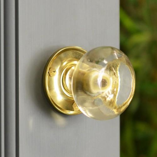 Clear Glass Rim Knob in Situ on a Grey Door