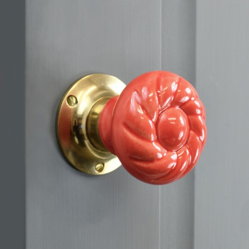 Strawberry Swirl Door knob on pastel grey door - finished with a polished brass backplate