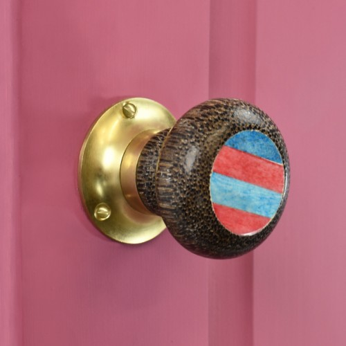 Blue & Red stripped door knob on Pink door with polished brass back plate
