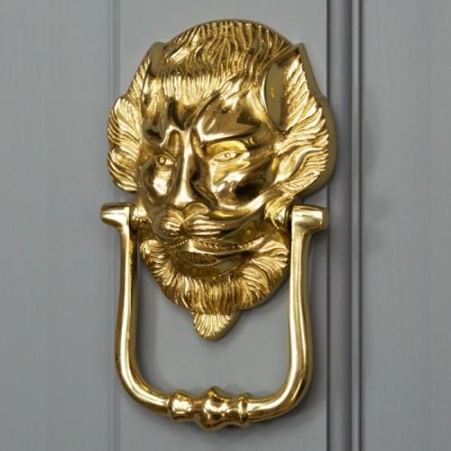 """""""Downing street lion"""" Door Knocker on a Grey Door"""