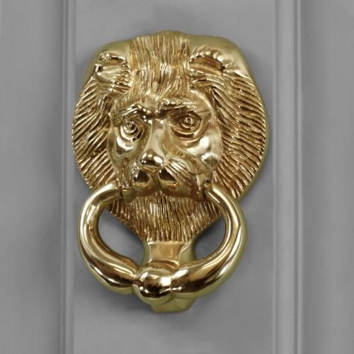 Polished Brass Dorchester Lion door knocker on grey door