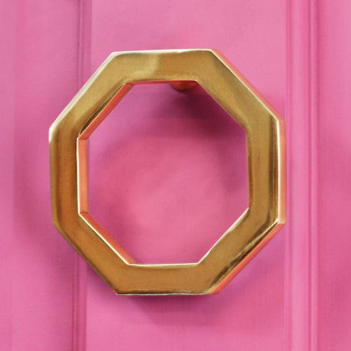 Polished brass Octagonal door knocker on pink door