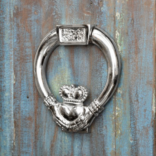 bright Chrome Claddagh Door Knocker on rustic door