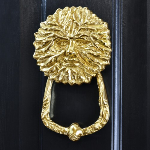 Polished Brass Green man door knocker on black door