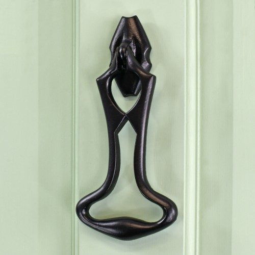 Black Iron Art Deco Door Knocker on green wood Door