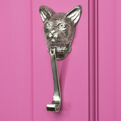 Bright Chrome Cat head door knocker on bright Pink Door