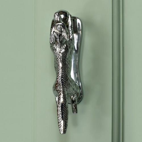 Bright Chrome Running fox door knocker on green door