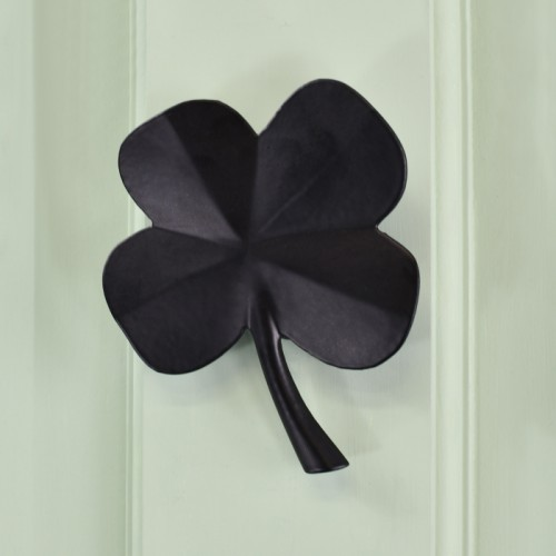 Black Four leaf clover door knocker on green door