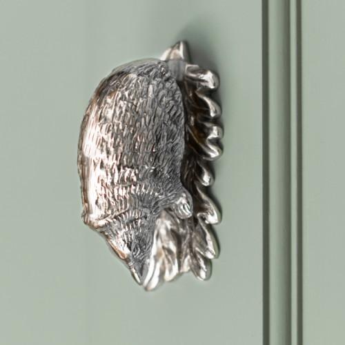 Bright Chrome Hedgehog door knocker on green door