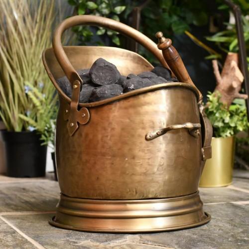 Beautiful antique bronze coal scuttle in living room