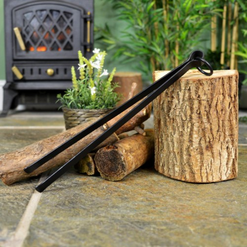 Black Simplistic Fireside Tong Next to the Fireplace