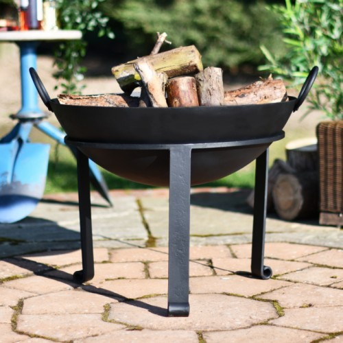 Traditional garden fire pit on patio