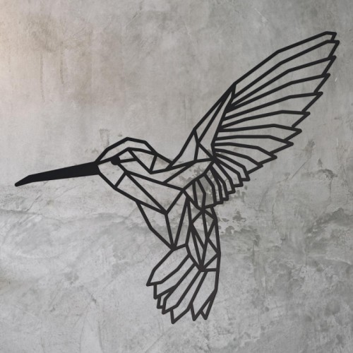 Geometric Steel Hummingbird Wall Art in on a Rustic Wall