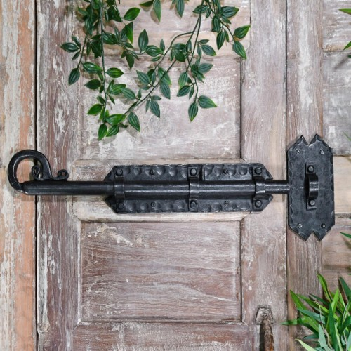 Grimoire Door Bolt in Situ on a rustic Wooden Door