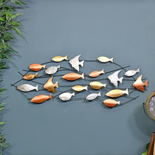 Metallic Swimming Fish Wall Art in Situ on a Blue Wall