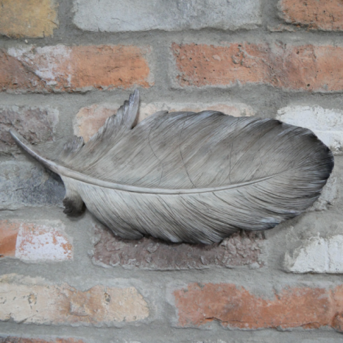 Painted Feather Wall Art in Situ on a Brick Wall