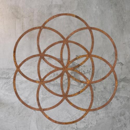 "Rustic ""Seed of Life"" Steel Wall Art on a Rustic Wall"
