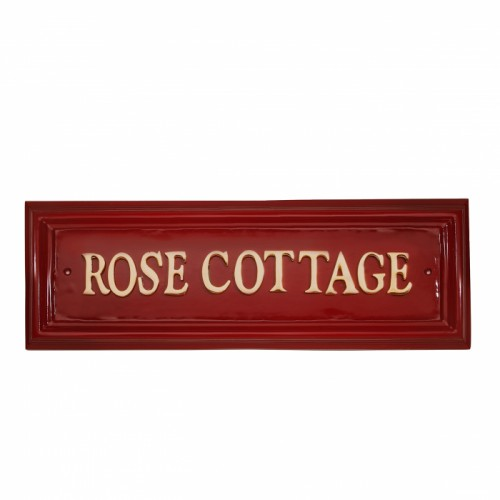 Red Rectangular house name sign with Brass letters