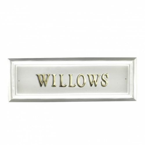 White rectangular house sign with Brass letters