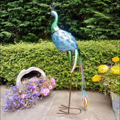 Tall metallic colourful peacock sculpture