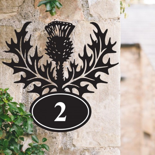 Thistle Iron House Number Sign on a Garden Wall